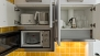 Seville Apartment - Kitchenette with utensils and appliances for self-catering.