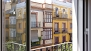 Seville Apartment - The bedroom, airy and bright, overlooks Feria street.