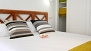 Sevilla Apartamento - The room has a built-in wardrobe to store your belongings.