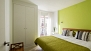 Sevilla Apartamento - Bedroom with twin beds, fitted wardrobe and a large window.