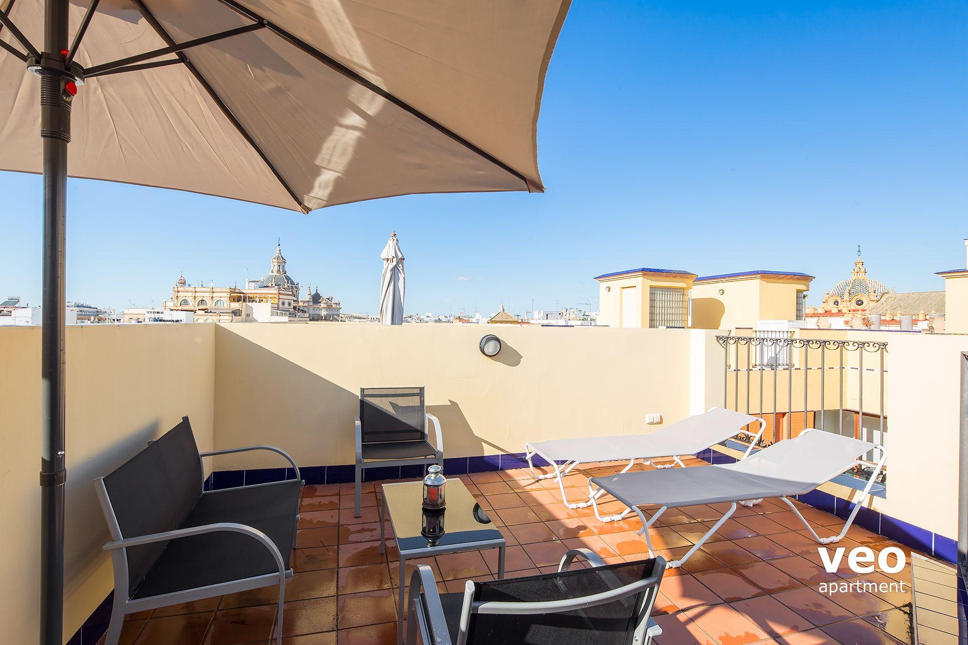 Seville apartment pajaritos street seville spain for Apartment terrace furniture