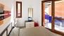 Seville Apartment - Bedroom with large sliding doors to a lower terrace.