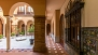 Seville Apartment - Patio of the house. It is decorated with traditional ceramic tiles and a colonnade of arches.