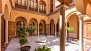 Seville Apartment - Patio of the house. Typical 'casa palacio' of the Sevillian Regionalist architecture.