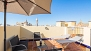 Seville Apartment - The terrace is equipped with garden furniture and parasol.