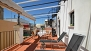 Seville Apartment - Private terrace with garden furniture, canopy and plants.