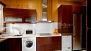 Seville Apartment - Kitchen with oven, washing machine, tumble dryer and all the main utensils for self-catering.