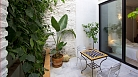 Seville Apartment - Private patio with outdoor seating and plants.