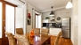 Seville Apartment - The bright dining space and the kitchen