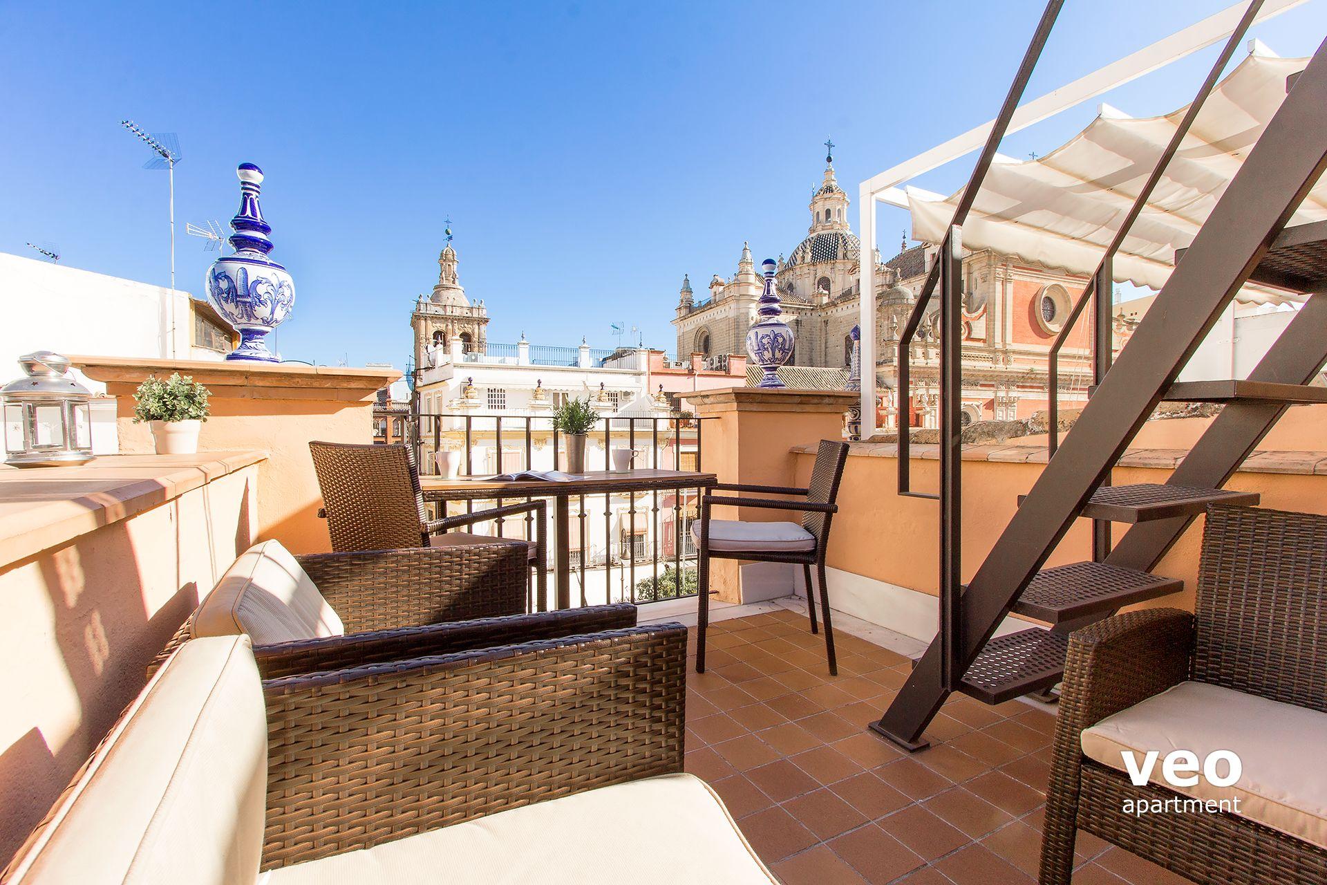 Seville apartment del salvador square seville spain for Apartment terrace furniture