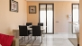 Seville Apartment - The dining area with french windows overlooking Calle Oropesa.