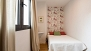 Sevilla Apartamento - Bedroom 3 with a double bed. The window faces a quiet inner patio.