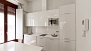 Sevilla Apartamento - The kitchen is well equipped. White units add to the sense of light in the apartment.