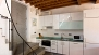 Granada Apartamento - The kitchen is modern and includes an oven, microwave and a washing machine.