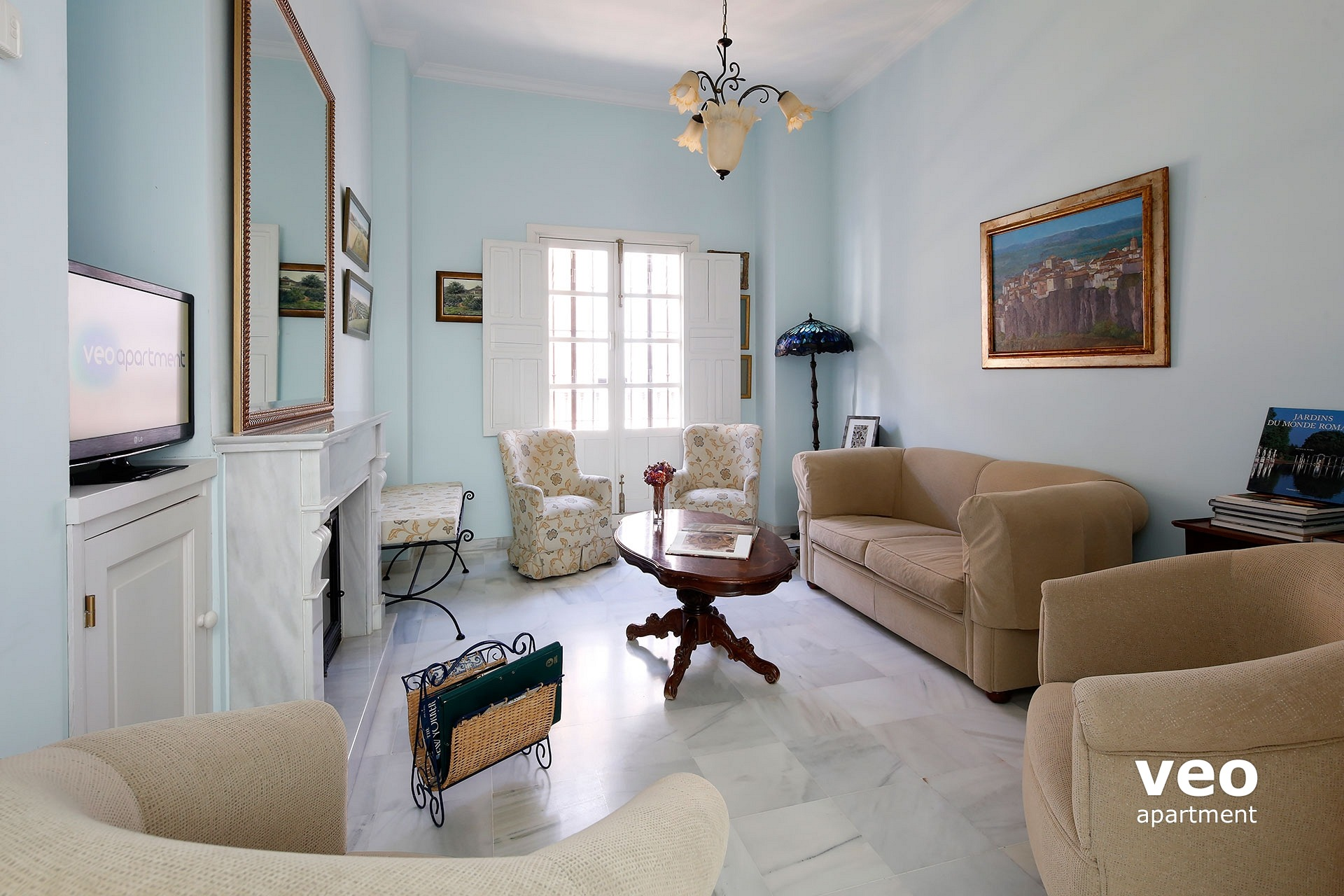 Seville apartment living room with a sofa for 2 4 armrchairs and a bench