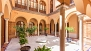 Seville Apartment - Patio of the house with a marble fountain in the centre.