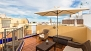 Seville Apartment - Private terrace. With lounge sofas, table, parasol and 2 deck-chairs.