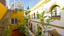 Seville Apartment - A steep iron stairway leads from the lower terrace to the roof-top terrace.