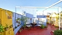 Seville Apartment - Roof-top terrace with outdoor shower, canopy, table and chairs.