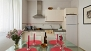 Seville Apartment - The kitchen is well equipped with cooking utensils and main appliances, including a washing machine.