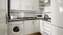 Seville Apartment - Kitchen well equipped for self-catering - with washing machine.