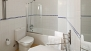 Seville Apartment - The bathtub has an overhead shower.
