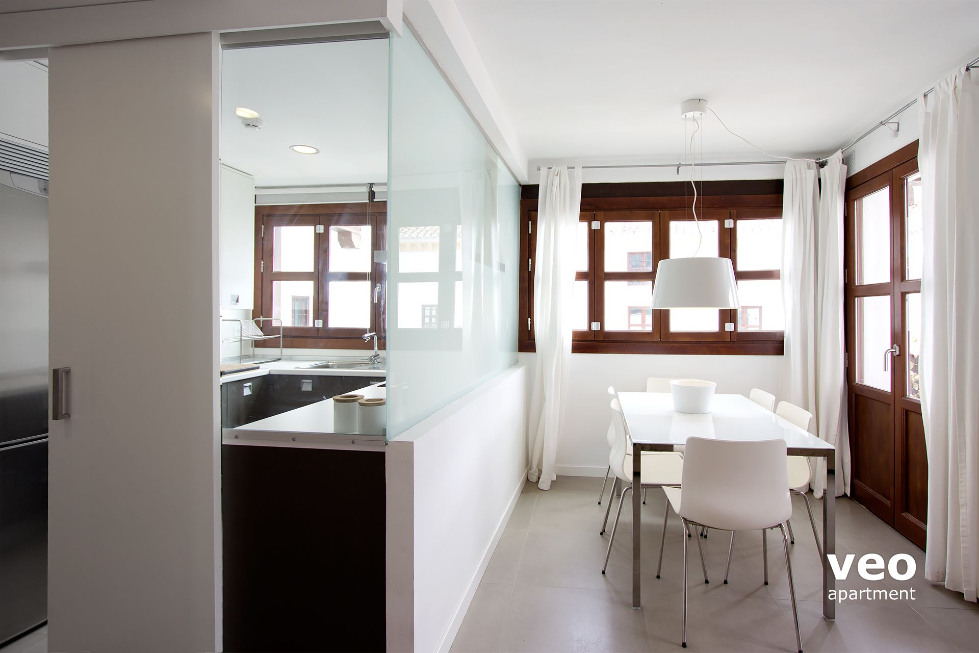 ... Granada Apartment   The Modern Kitchen Is Separated By A Glass  Partition And Sliding Doors.