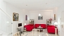 Seville Apartment - Spacious living area with 3 sofas, central table, TV and DVD player.