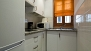 Sevilla Apartamento - Kitchen equipped with utensils and appliances for self-catering.