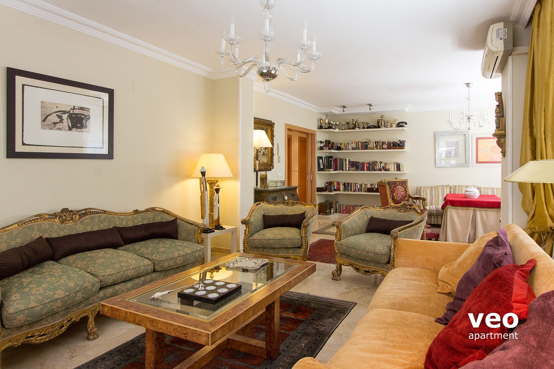 Superb Granada Apartment   The Living Area Is Decorated With Antiques, Wood  Furniture And Original Artwork ...