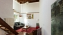 Seville Apartment - View towards the living area. With high wood beamed ceilings and terracotta flooring.