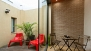 Seville Apartment - Patio with outdoor furniture and plants.