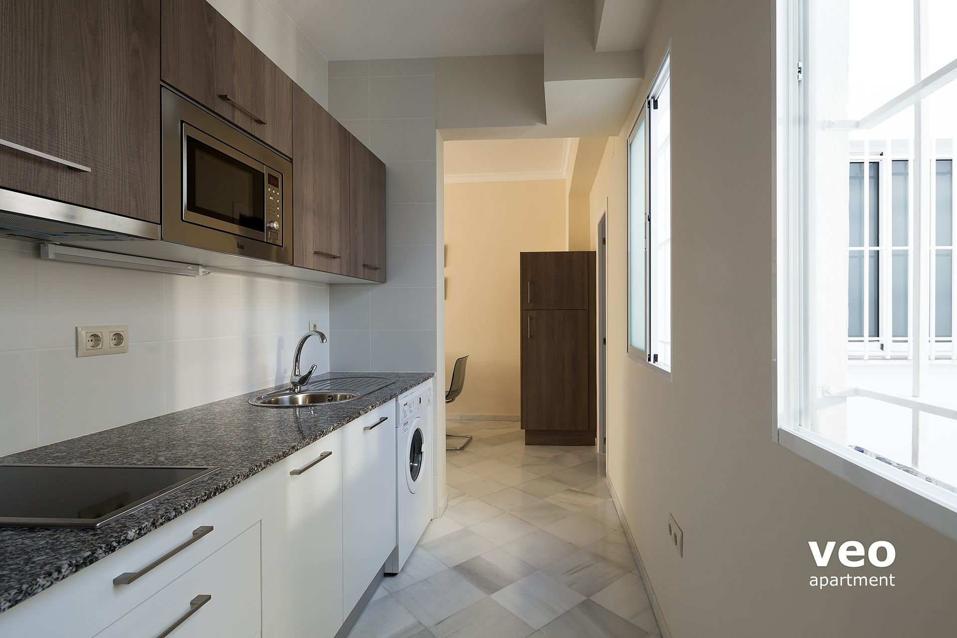 seville apartment galley kitchen in the entrance area well equipped for self catering