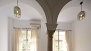 Seville Apartment - A colonnade of arches in the sleeping area.