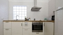 Seville Apartment - Kitchen with utensils and appliances for self-catering.