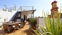 Seville Apartment - Lower terrace with 40sqm decorated with plants and garden furniture.