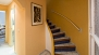 Seville Apartment - Stairs lead to the upper level with: bedroom N� 3, living room, kitchen and terrace.