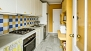Seville Apartment - Kitchen with all main utensils and appliances for self-catering. With oven, dishwasher and washing machine.