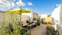 Seville Apartment - Terrace No.1 (shared). It is equipped and decorated with plants, parasol and lounge sofas.