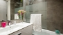 Sevilla Apartamento - The second bathroom has bathtub with an overhead shower.