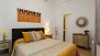 Sevilla Apartamento - Bedroom with double bed and en-suite bathroom.