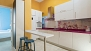 Seville Apartment - Modern kitchen with utensils for cooking and main appliances.