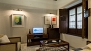 Sevilla Apartamento - Living area with TV. There is free WIFI internet access.