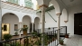 Seville Apartment - The apartment forms part of a Casa Palacio decorated with a colonnade of arches.