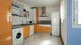 Seville Apartment - Open-plan kitchen equipped with utensils and appliances - washing machine and dishwasher included.