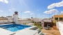Seville Apartment - Sun-filled terrace with pool, deck chairs and garden furniture.
