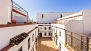 Seville Apartment - View of the building courtyard from the terrace.